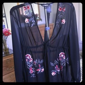 Express sheer black blouse with flower stitching